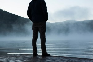 man standing at lake
